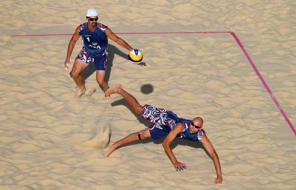 Todd Rogers, left, and Phil Dalhausser will return home without an Olympic medal.