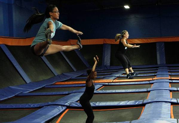 Kristine Gagarian, 27, left, Ingrid Hughes, 40, and Siri Berting, 39, go through a regime in a Skyrobics class at Sky Zone in Gardena.