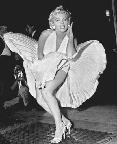 """Marilyn Monroe poses over the updraft of New York subway grating while in character for the filming of """"The Seven Year Itch"""" in Manhattan."""