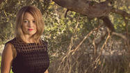 Singer-songwriter and fiddle player Sara Watkins is known best for being one-third of the Grammy Award-winning bluegrass band Nickel Creek.