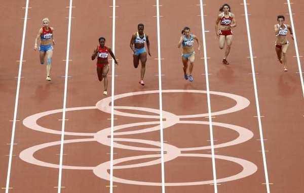 From left, Russia's Olga Belkina, United States' Carmelita Jeter, Bahamas' Sheniqua Ferguson, Kazakhstan's Olga Bludova, Malta's Diane Borg and Poland's Marta Jeschke compete in a women's 100-meter heat Friday.