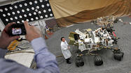 Mars dust storm, minor wobble give Curiosity scientists pause