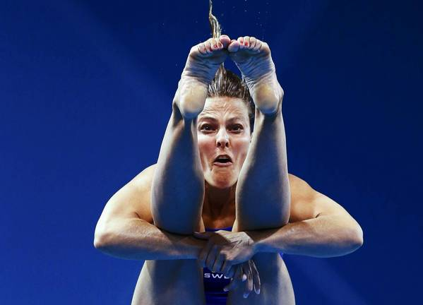 Sweden's Anna Lindberg performs a dive during the women's 3m springboard preliminary round at the London 2012 Olympic Games at the Aquatics Centre.