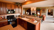 "Moving into a new home in your golden years can be invigorating. Not only can you finally get that granite countertop and scrapbooking room, but you can also ""buy"" maintenance free living, energy-saving conveniences and even a sense of community. The good news is you have choices — and the even better news is the market is waiting to woo you."