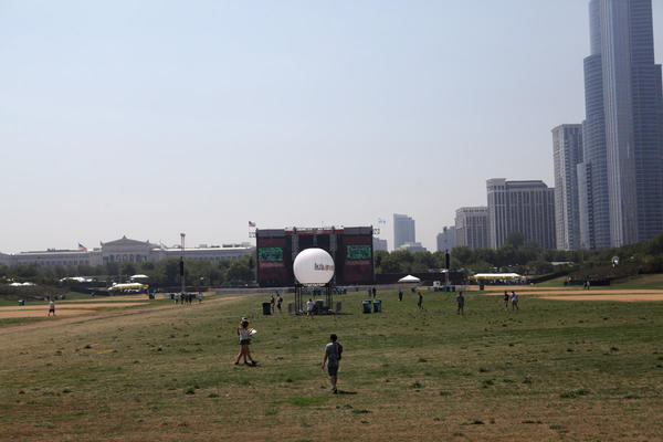 Concert goers walk aross Grant Park towards the Red Bull stage at Lollapalooza Friday August 3, 2012.