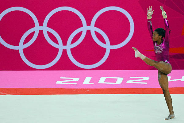 "Gabrielle Douglas during the floor exercise on Aug. 2. Douglas became only the fourth U.S. woman to win a gold medal in the ladies individual all-around after beating <a class=""taxInlineTagLink"" id=""PLGEO00000025"" title=""Russia"" href=""/topic/intl/russia-PLGEO00000025.topic"">Russia's</a> best to take the top prize."
