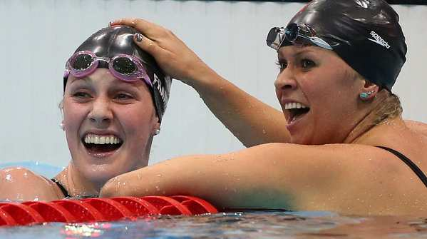 Missy Franklin, left, and U.S. swimming teammate Elizabeth Beisel celebrate at the finish line of the women's 200m backstroke.  Franklin led wire-to-wire.