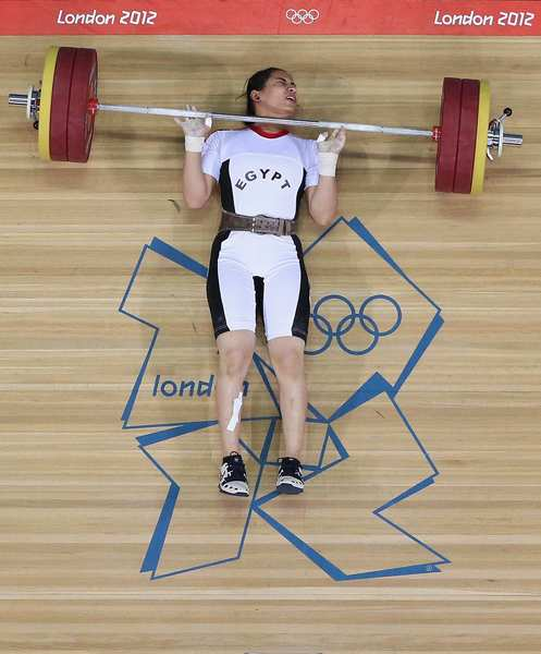 Khalil Mahmoud K Abir Abdelrahman of Egypt fails to complete a lift during the women's weightlifting final.