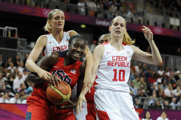 USA center Tina Charles (14) battles for a rebound with Czech Republic center Alena Hanusova (10) and guard Katerina Zohnova (7) in the women's preliminary game during the London 2012 Olympic Games at Basketball Arena.
