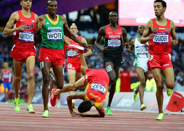 Spain's Diego Ruiz tumbles near end of a men's 1,500m heat.