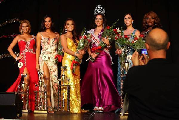 "From left, Miss New York, Miss Oklahoma, Miss Wyoming, Miss West Virginia, Miss Tennessee and Miss California pose for the cameras after the Miss Queen USA pageant at the Circus Disco in Los Angeles on Sunday night. Queen USA calls itself ""the premier transgender beauty pageant in the United States."""