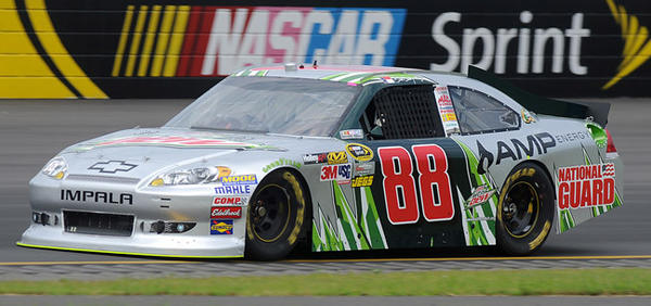 Dale Earnhardt Jr., driver of the #88 Diet Mtn. Dew/AMP Energy/National Guard Chevrolet navigates through turn three during the first practice for the 39th Annual Pennsylvania 400 at Pocono Raceway Friday afternoon.