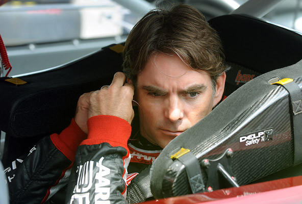 Jeff Gordon driver of the #24 Drive to End Hunger Chevrolet adjusts his earplugs prior to the start of the first practice for the 39th Annual Pennsylvania 400 at Pocono Raceway Friday afternoon.