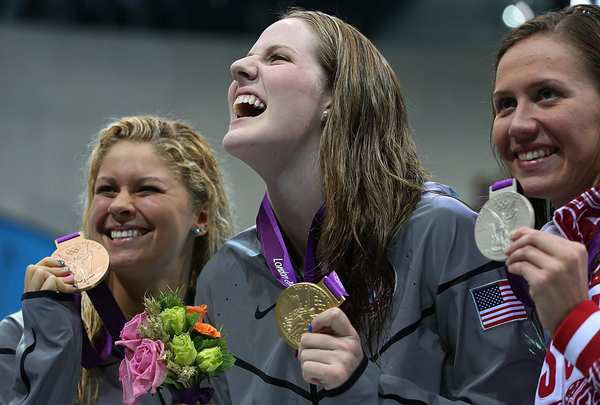 U.S. swimmer Missy Franklin, center, enjoys the medal ceremony with teammate Elizabeth Beisel, left, and Russia's Anastasia Zueva.   Franklin won the gold, setting a world record of 2:04.06.  Beisel took  the bronze and Zueva silver.