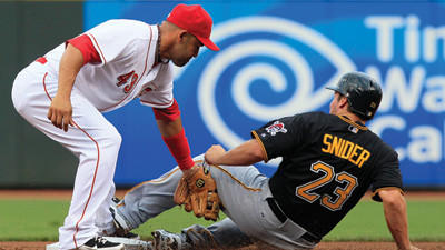 Pittsburgh Pirates' Travis Snider steals second base as Cincinnati Reds second baseman Miguel Cairo is late with the tag in the first inning on Friday night.