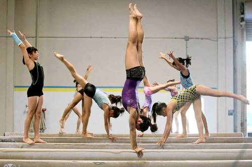Young gymnasts train at Gym-Max Academy of Gymnastics in Costa Mesa on Thursday. U.S. Olympic gymnast Kyla Ross has trained here for years before her Olympic appearance.