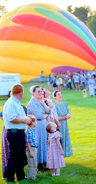 Spectators watch as balloons take flight Friday night from Green Grove Gardens in Greencastle during the festival's first day.