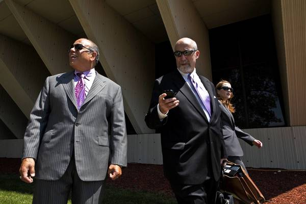 Defense attorneys Joe Lopez, from left, Joel Brodsky and Lisa Lopez leave court Friday after the first week of the Drew Peterson trial.