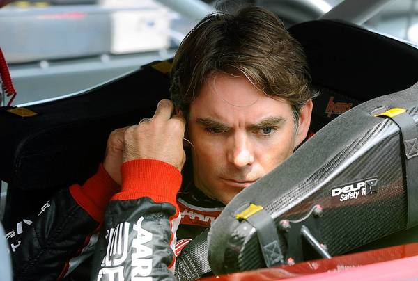 Jeff Gordon, driver of the #24 Drive to End Hunger Chevrolet, adjusts his earplugs prior to the start of the first practice for the 34th Annual Pennsylvania 400 at Pocono Raceway Friday afternoon.