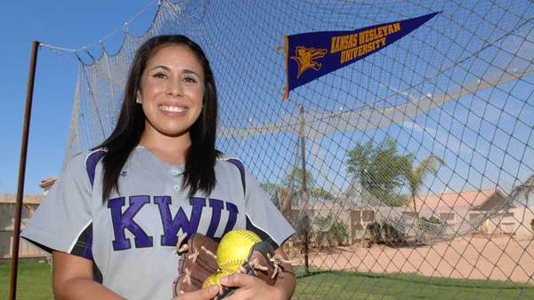 Calexico High and Kansas Wesleyan University alumnus Cassandra Roldan poses for a photo next to a batting cage Thursday at her Calexico home.