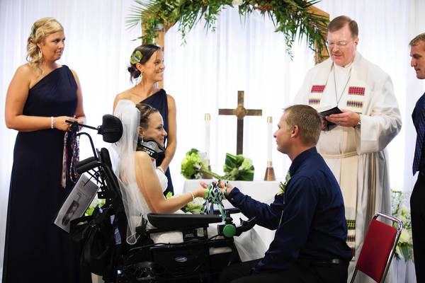 Katie Wahl and Jeremy Johnson marry at the Rehabilitation Institute of Chicago on July 14, where Katie is undergoing therapy for a spinal injury that occurred at her bachelorette party.