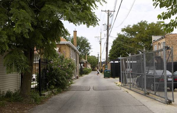The alley off California Avenue and 55th Street is concrete and asphalt now, no longer the cinder lane of John Kass' youth. It was a place for escape then, like all children need.