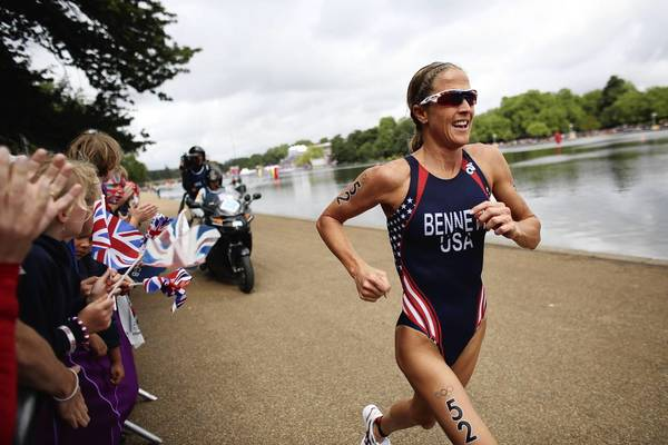Laura Bennett of the USA competes in the running stage of the Women's Triathlon event at the London 2012 Olympic Games in Hyde Park. Nicola Spirig of Switzerland won the race.