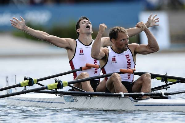 Denmark's Mads Rasmussen, left, and Rasmus Quist celebrate after winning the gold medal in the men's lightweight double sculls final of the rowing event during the London 2012 Olympic Games.