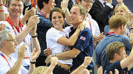 Britain's Prince William and Kate Middleton have proved to be quite a hit at this year's Olympics and they shared an exciting PDA moment on Thursday while watching events at the London 2012 Games.