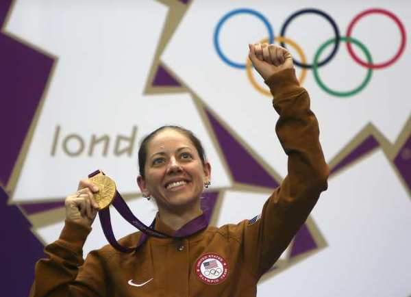 American Jamie Gray proudly displays her gold medal in the women's 50-meter rifle three-position shooting competition.
