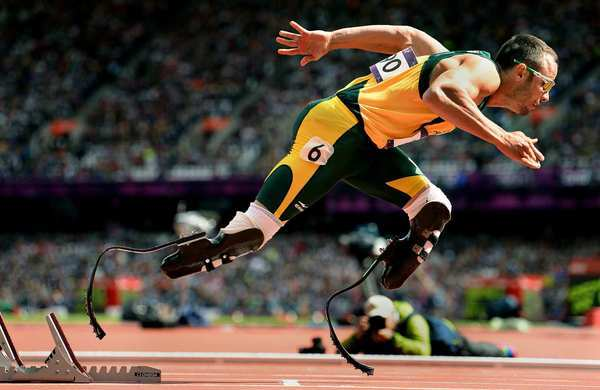 South Africa's Oscar Pistorius, aka the 'Blade Runner' because of his carbon-fiber prosthetics, takes off from the starting blocks in the first round of heats for the 400-meter race at the London Olympics on Saturday.