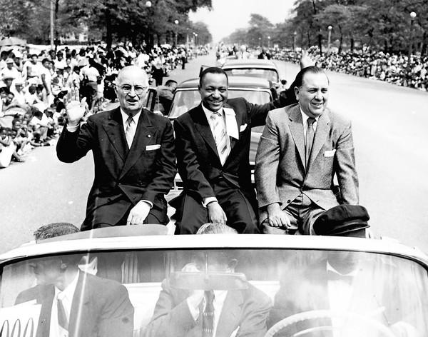 In 1956, former President Harry Truman, left, joined Chicago Defender publisher John Sengstacke and Mayor Richard J. Daley at the head of the South Side's Bud Billiken Parade.
