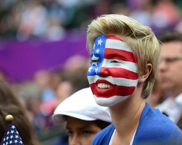 A U.S. supporter follows the   Olympic  men's doubles gold medal match between Mike and Bob Bryan of the United States and France's Michael Llodra and Jo-Wilfried Tsonga. The American duo won the match.