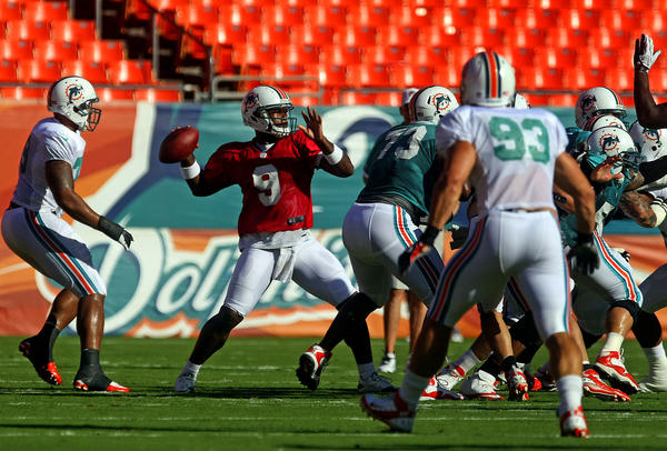 Dolphins quarterback David Garrard throws the ball during the team's first scrimmage Sun Life Stadium.