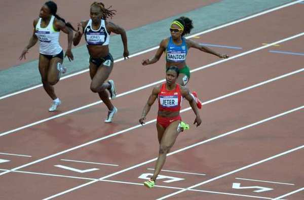 Carmelita Jeter crosses the finish line first in her 100-meter semifinal race.