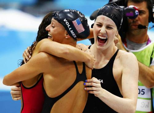 Dana Vollmer (C), Rebecca Soni (L) and Missy Franklin (R) embrace after a world record gold medal win in the women's 4x100m medley relay.