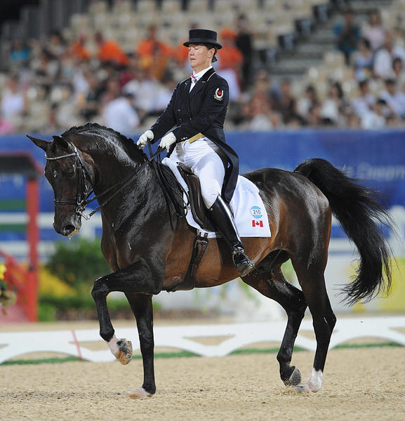 Canada's Jacqueline Brooks, 44, who is competing in the equestrian dressage event at the 2012 Olympics, had not been born when rival equestrian Hiroshi Hoketsu entered his first Olympics, the 1964 Tokyo games.