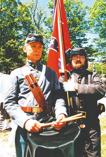 Tom Law, left, and an unidentified re-enactor are pictured in 1995 at a memorial event in Baltimore.