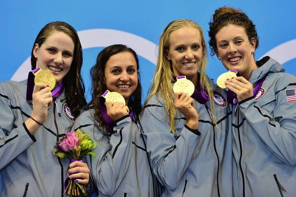 U.S. swimmers Missy Franklin, Rebecca Soni, Dana Vollmer, Allison Schmitt pose on the podium with the gold medal after winning the women's 4x100 medley relay final.