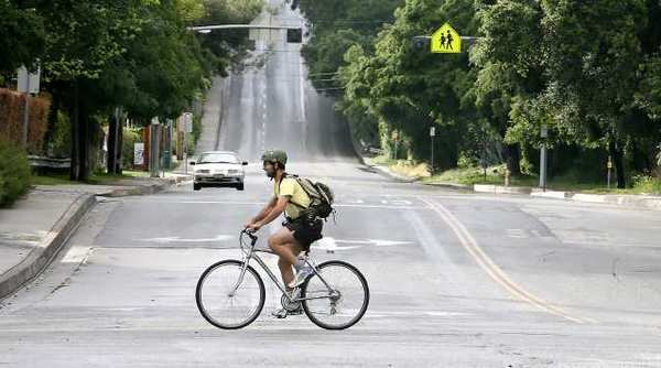 A bicyclist makes his way down Oak Grove Drove past Foothill Boulevard.The city is putting together a bike transportation plan.
