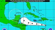 Tropical Storm Ernesto, forecast to intensify into a hurricane as it trots west across the Caribbean, may spare Jamaica from its most nasty weather on Sunday.