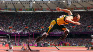 LONDON — Oscar Pistorius marches into Olympic Stadium with a limping gait of an old man, and the only thing you see, the only place you look, the only thing that matters, are his legs.
