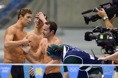 Matthew Grevers, Michael Phelps and Brendan Hansen react after winning gold in the men's 4x100m medley relay.