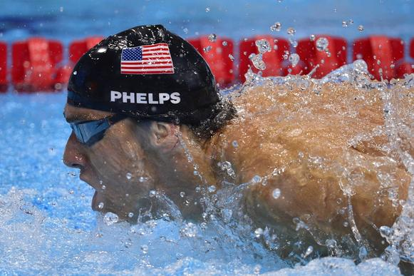 Michael Phelps swims the butterfly during the 4x100m medley relay on Saturday.