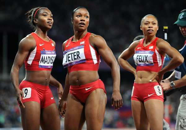 American sprinters, from left, Tianna Madison, Carmelita Jeter and Allyson Felix watch the replay after the 100m race.   Jeter was the only one to place, taking home a silver medal.