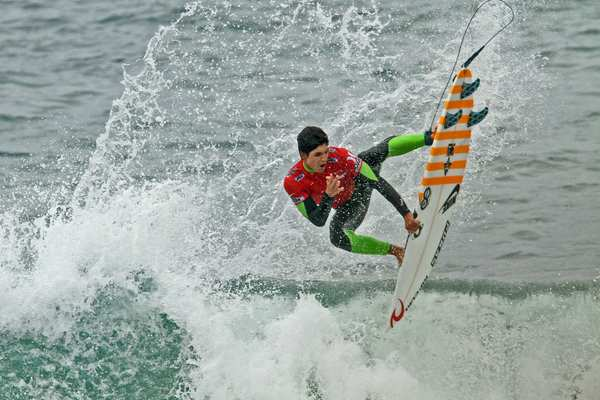 Gabriel Medina of Brazil performs in the competition.