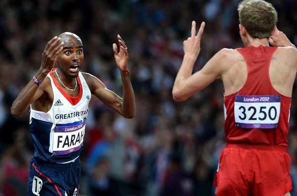 Great Britain's Mohamed Farah, left, celebrates his victory in  the 10,000-meter race with  second-place finisher Galen Rupp of the United States.