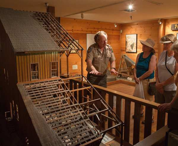 Curator Randy Bolt explains a mining display to visitors at the California State Mining and Mineral Museum in Mariposa. The future of the museum has yet to be decided but locals want to keep the gems and minerals on display for the public to enjoy.