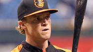 Orioles purchase contract of outfielder Nate McLouth, designate Endy Chavez for assignment