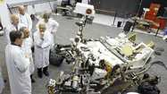 The rover Curiosity is expected to transmit a huge scientific payload from Mars, and the mission may also heavily influence how lawmakers in Washington, D.C., decide to spend money on the space race.
